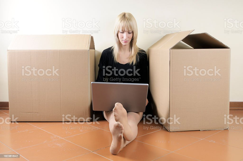 Girl Using PC after Moving House royalty-free stock photo