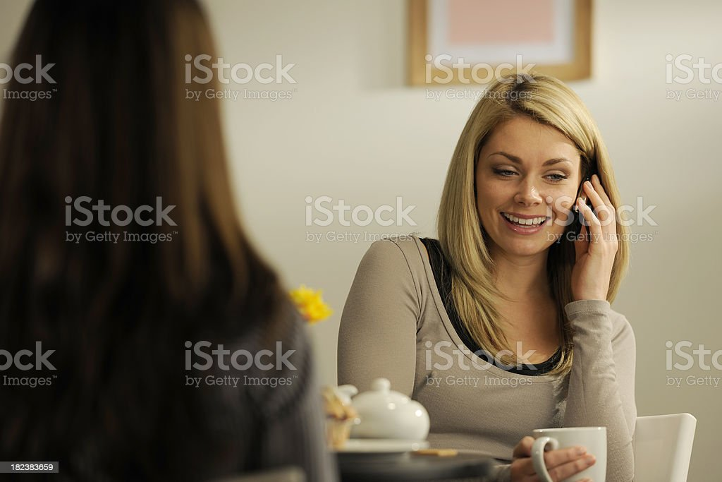 girl using phone in coffee shop royalty-free stock photo