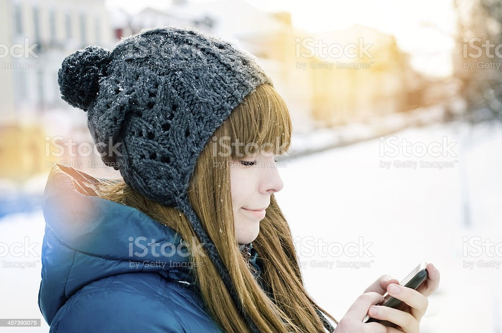 girl using smart phone outdoors royalty-free stock photo