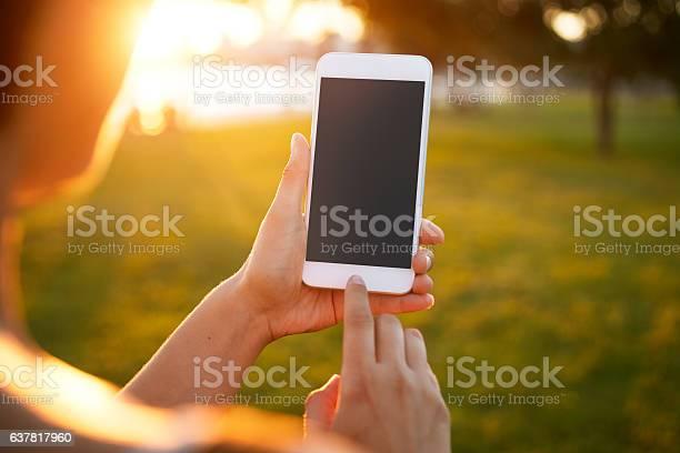 Girl using smart phone picture id637817960?b=1&k=6&m=637817960&s=612x612&h=xzpbb4tkfmhfvg brsqnngoey6sfkys0bd8mo2u392s=