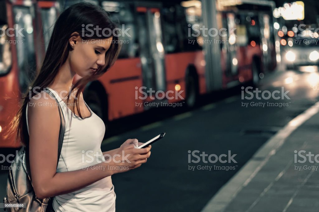 girl using smartphone at night stock photo