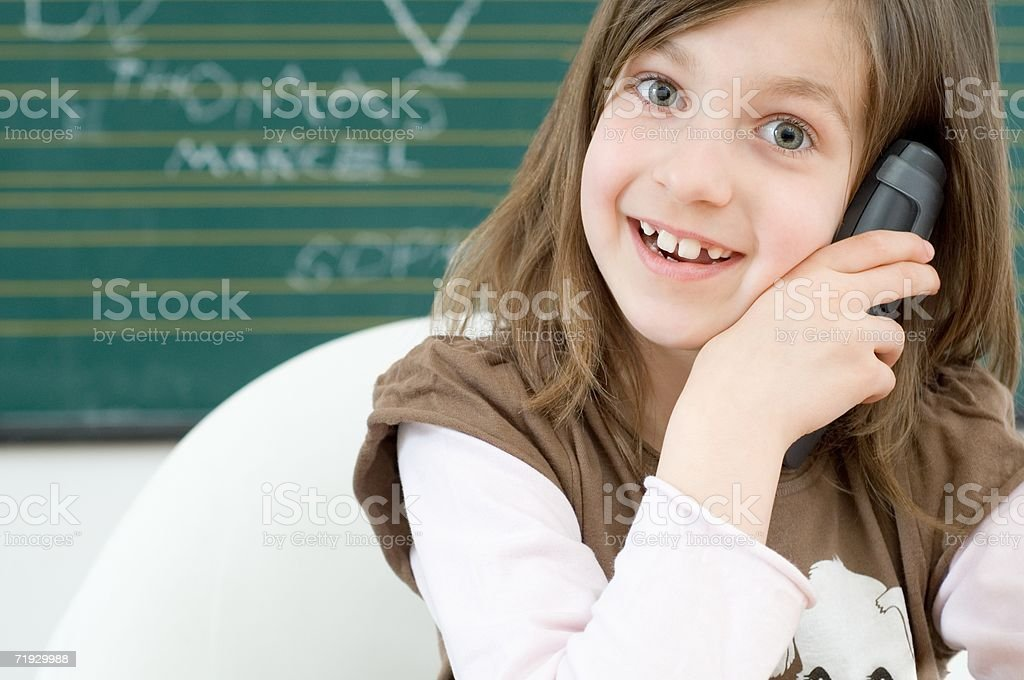 Girl using telephone royalty-free stock photo