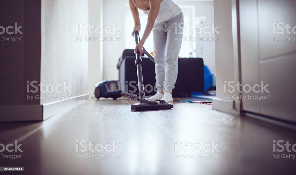 Girl vacuuming stock photo
