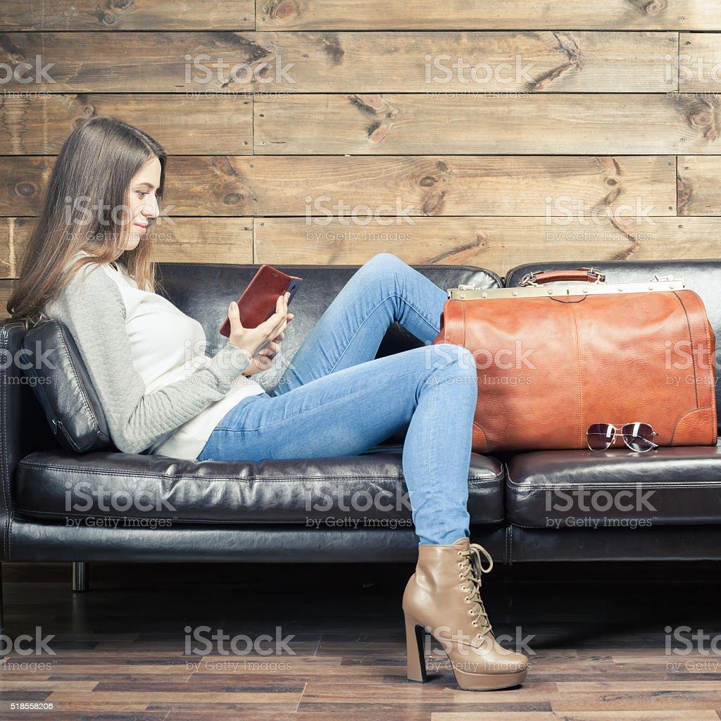 Girl waiting airplane in VIP lounge rom, airport stock photo
