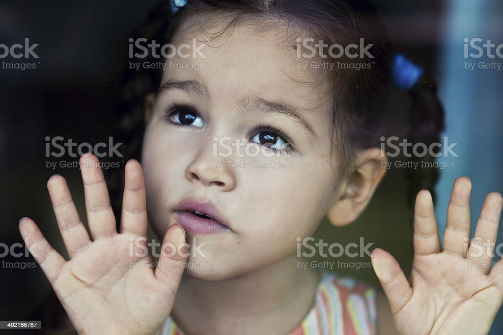 Girl waiting by the window stock photo