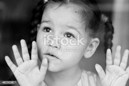 istock Girl waiting by the window 462300821