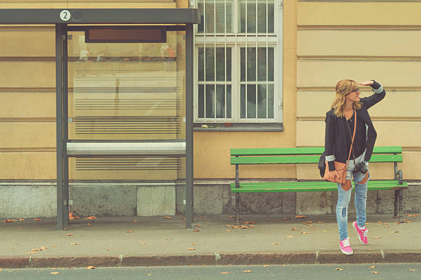 Girl waiting for a bus. stock photo