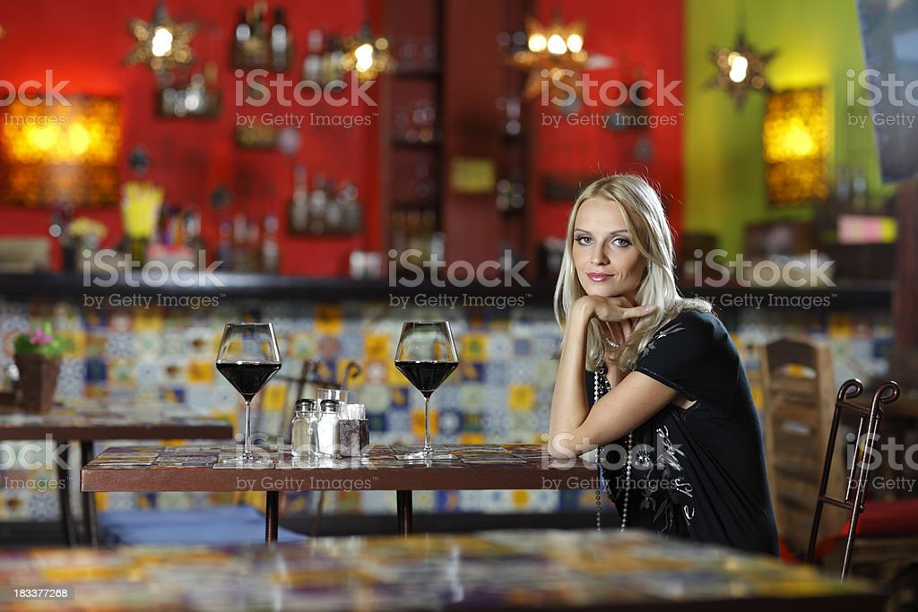 girl waiting for her boyfriend in a Mexican restaurant stock photo