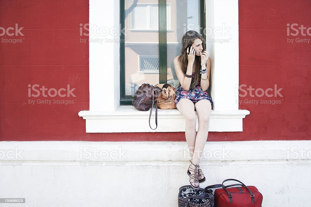girl waiting for someone stock photo