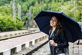 Beautiful girl waiting on the railway station