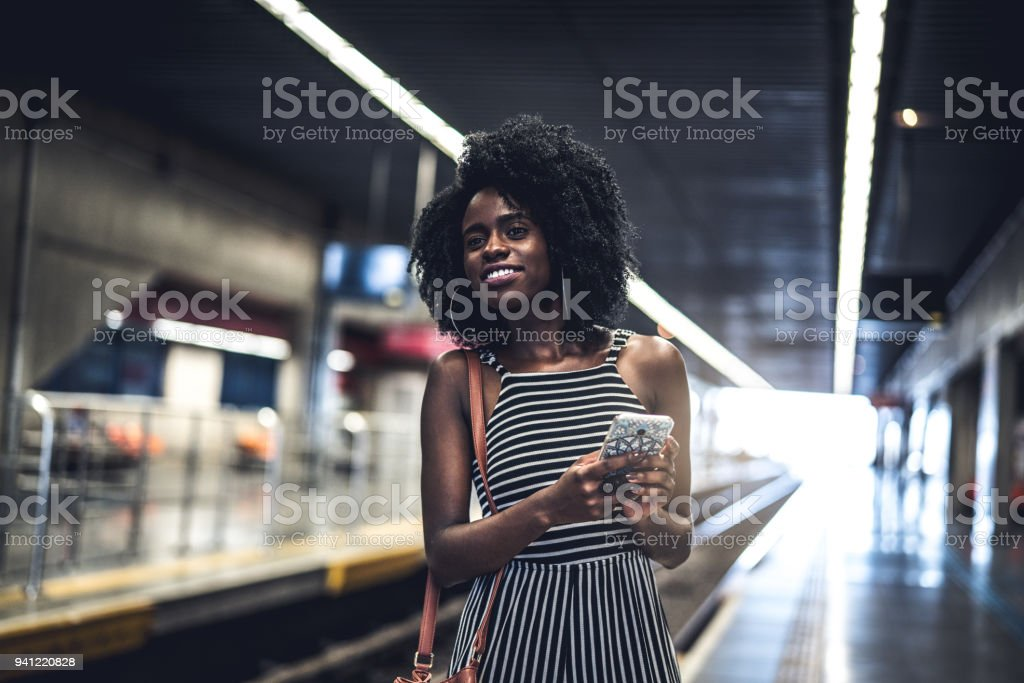 Girl waiting the train at station stock photo