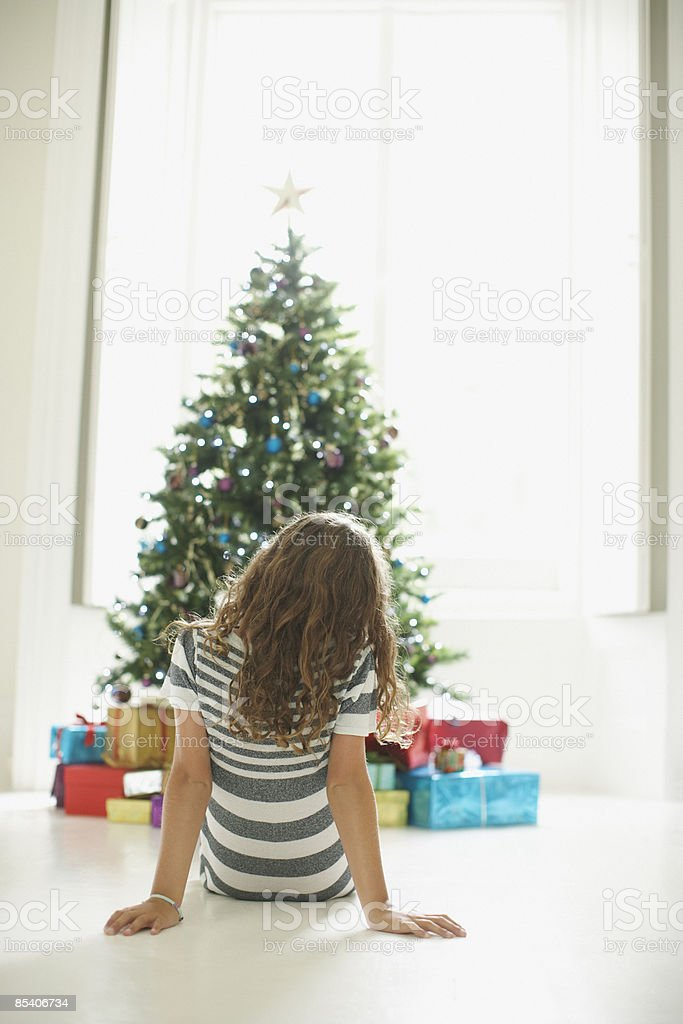 Girl waiting to open Christmas gifts royalty-free stock photo