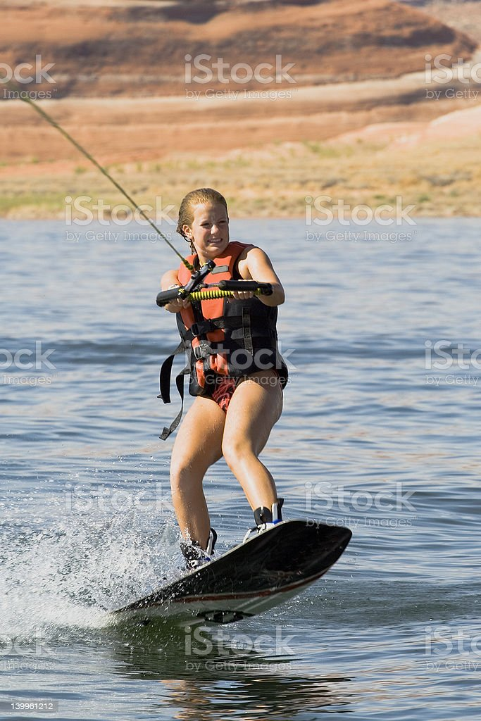 Girl Wakeboarding at Lake Powell royalty-free stock photo
