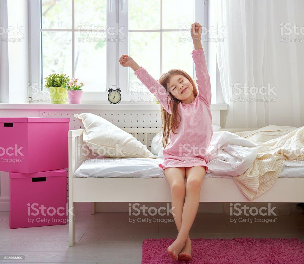 girl wakes up stock photo