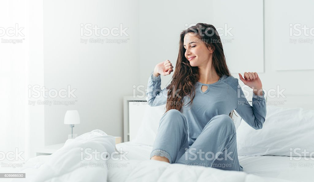Girl waking up and stretching – Foto