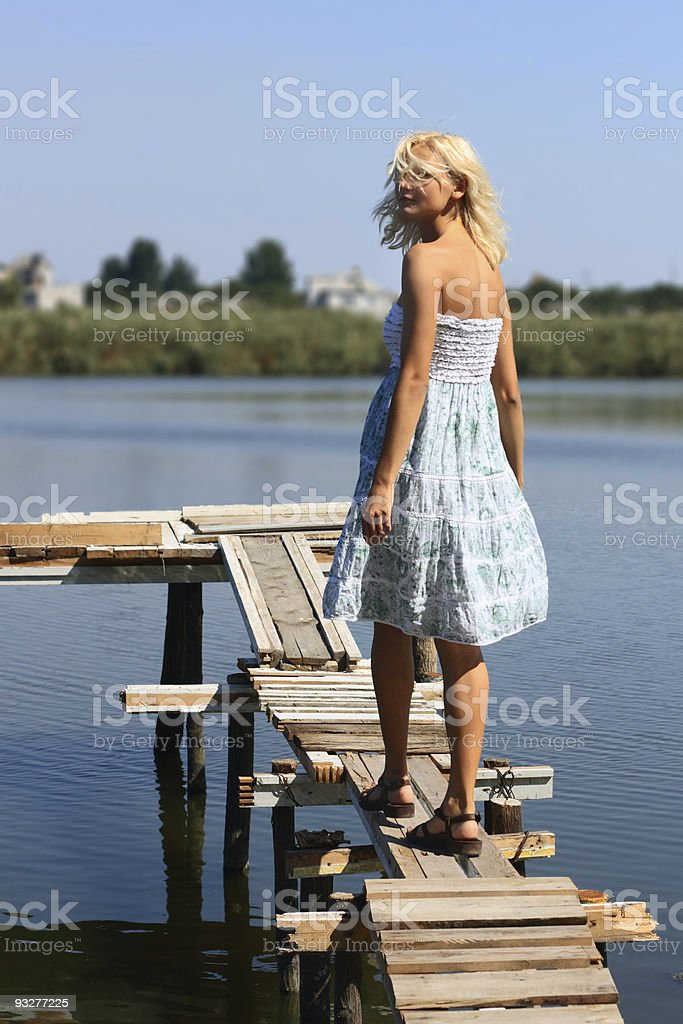 Girl walking along the pier royalty-free stock photo
