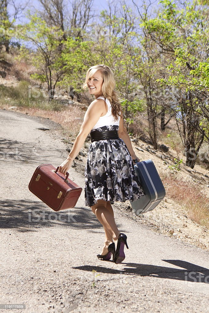Girl Walking Down Path Looking Over Her Shoulder royalty-free stock photo