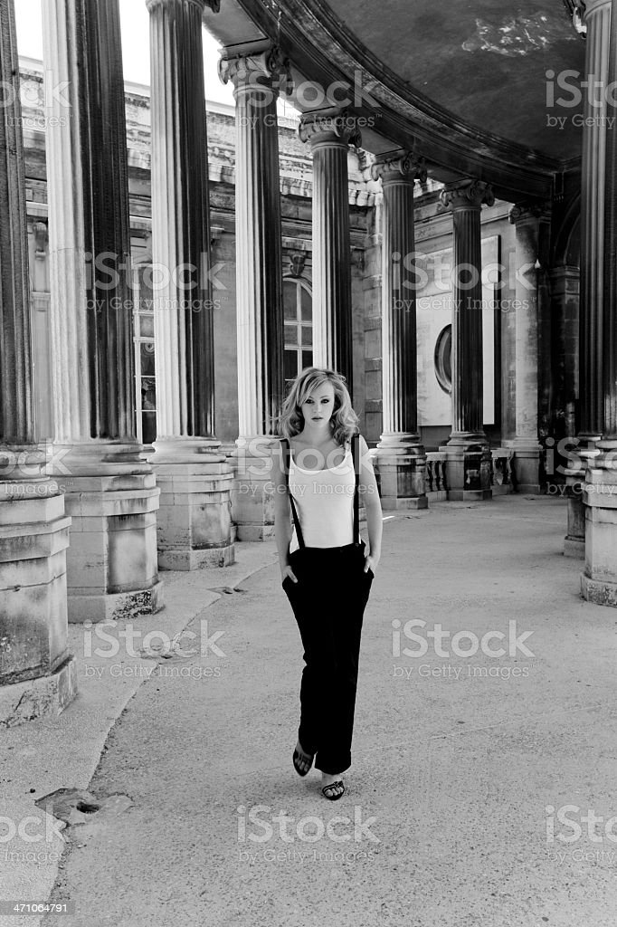 Girl walking in Archway (BW) stock photo