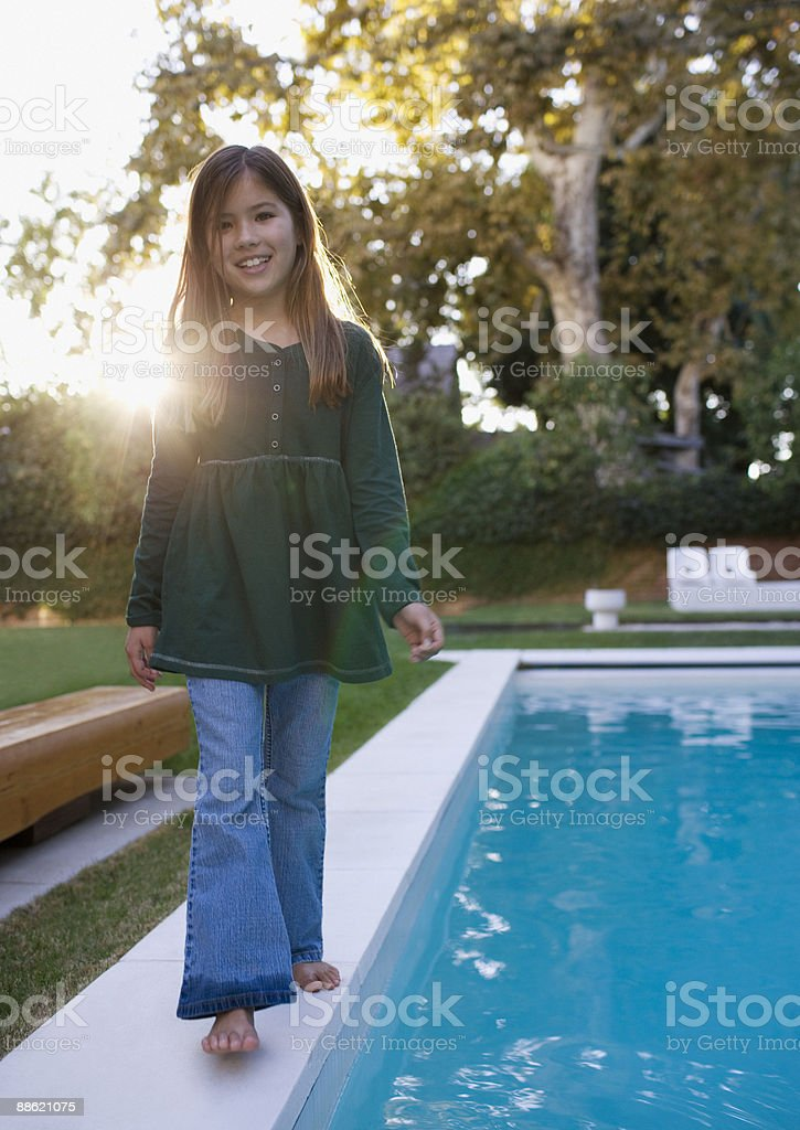 Girl walking near swimming pool royalty-free stock photo