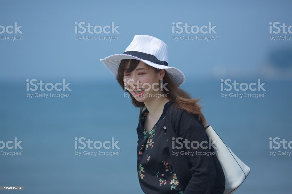 Girl walking on beach royalty-free stock photo