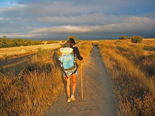 Girl walking on Camino de Santiago  pilgrim stock pictures, royalty-free photos & images