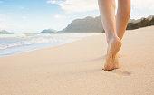 Girl walking on the beach in Hawaii