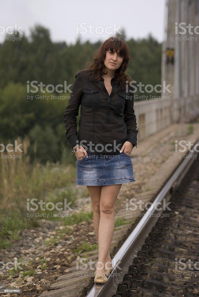 Girl walking on the railway royaltyfri bildbanksbilder