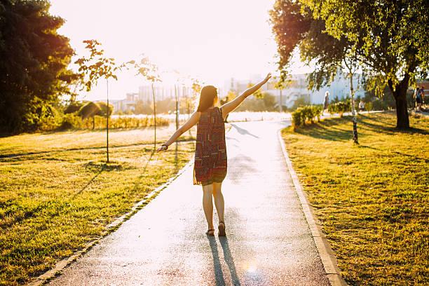 Girl walking on the sunset stock photo