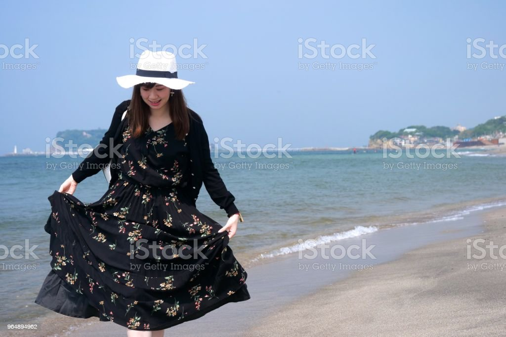 Girl walking on wet sandy beach royalty-free stock photo
