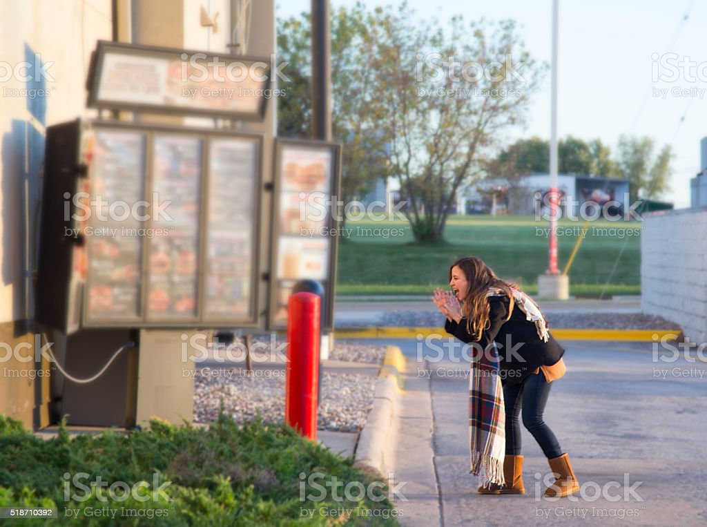 Girl walking through the drive through stock photo