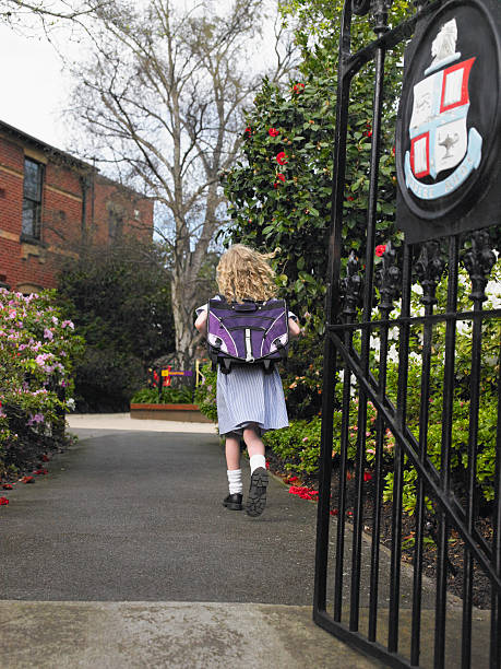 girl walking to school - private school stock photos and pictures