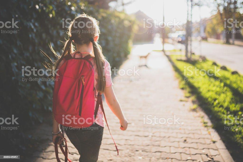 Girl walking to school royalty-free stock photo