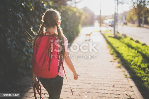 istock Girl walking to school 888946962