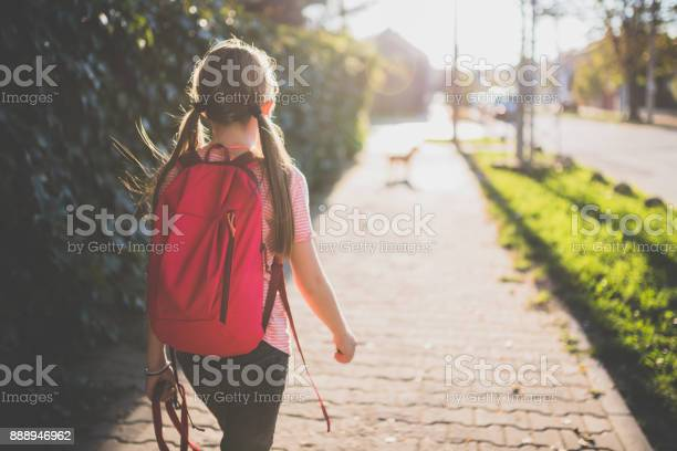 Girl walking to school picture id888946962?b=1&k=6&m=888946962&s=612x612&h=p bp ifuiwdcsirxqigdty07ziaelary6saxsr9onbo=