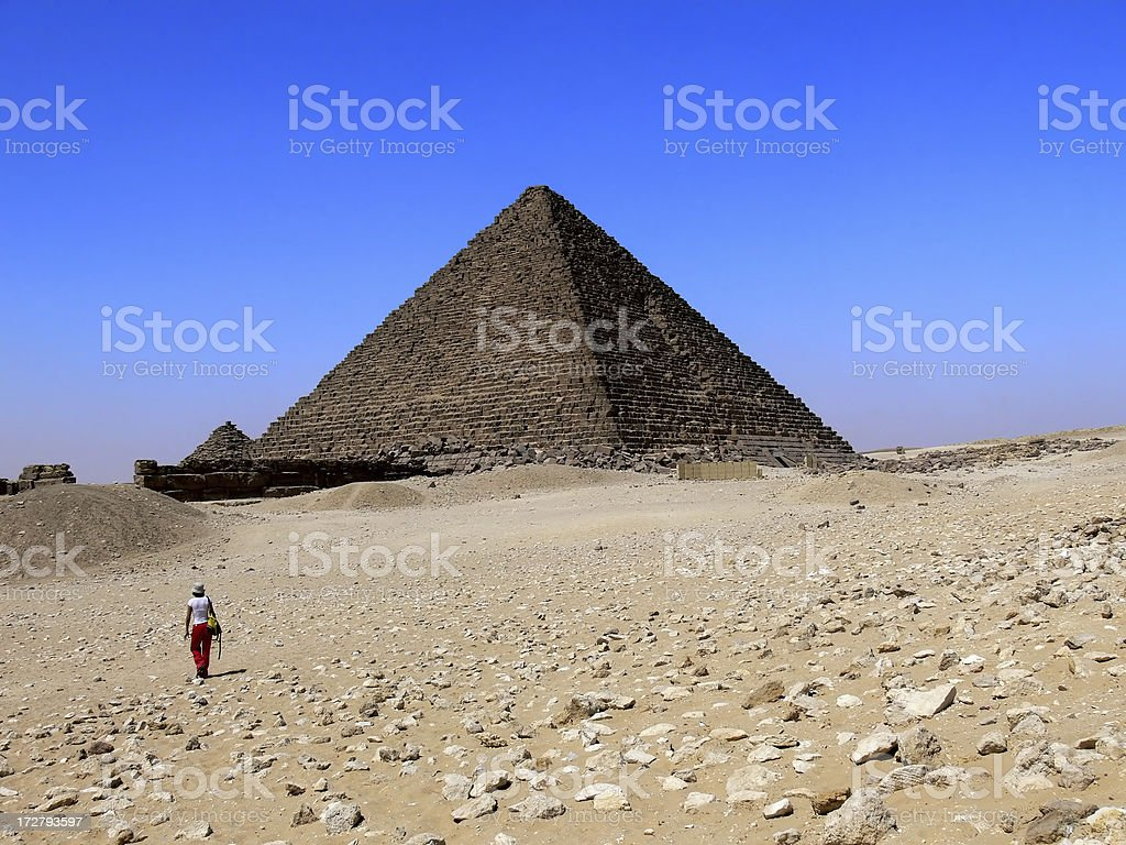 Girl walking to the Pyramid stock photo