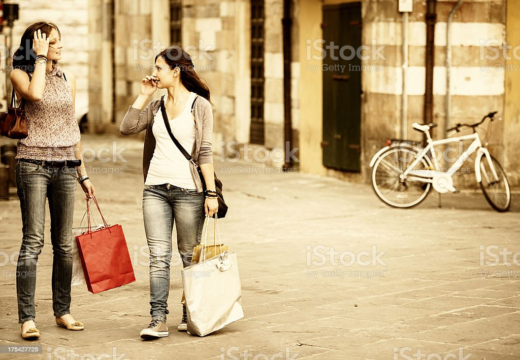 Girl walking with shopping bag on the city royalty-free stock photo