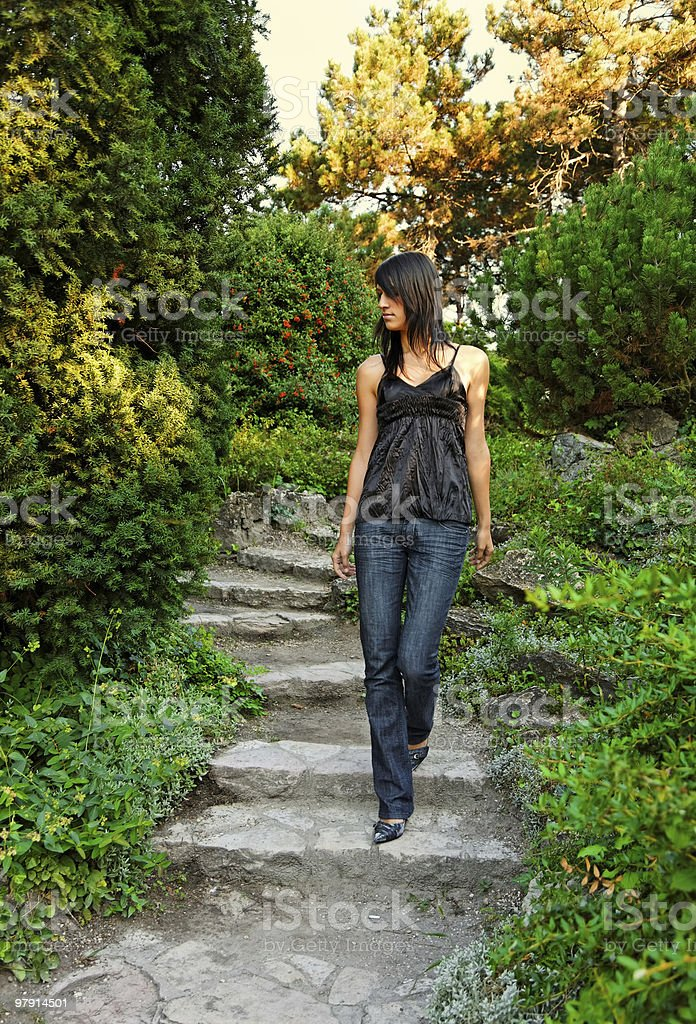 girl walks down on the garden stairs royalty-free stock photo
