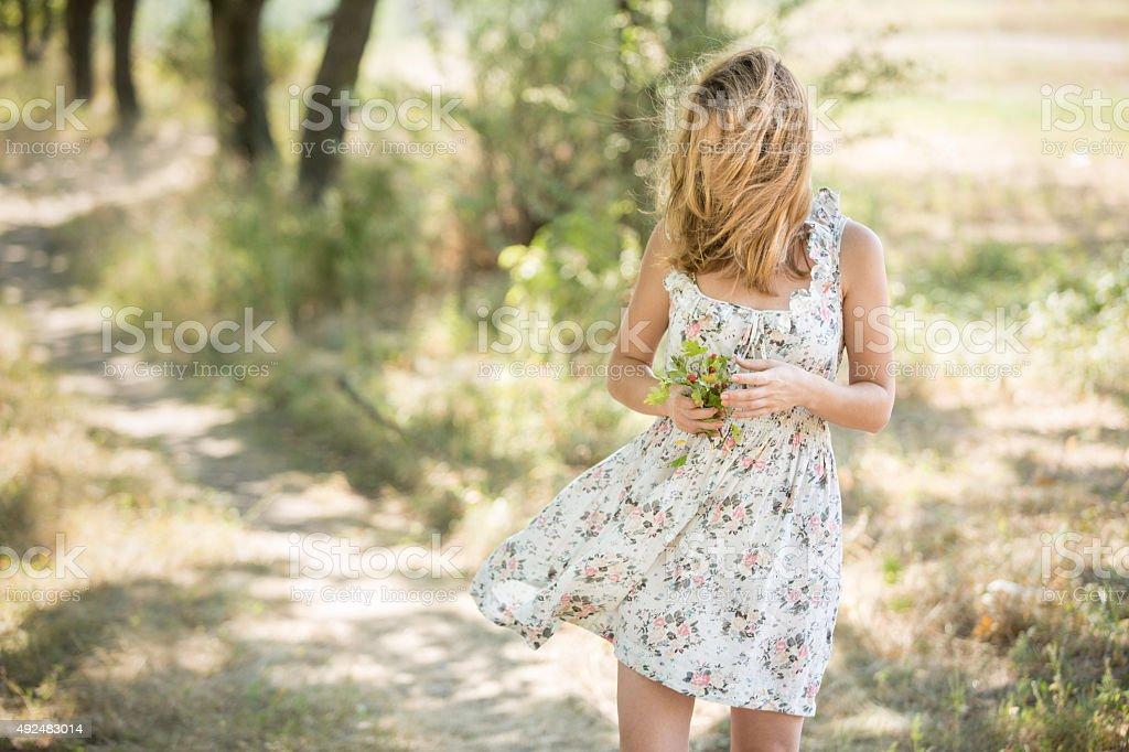 Girl walks in the park. stock photo