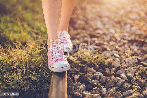 Girl walks the train tracks