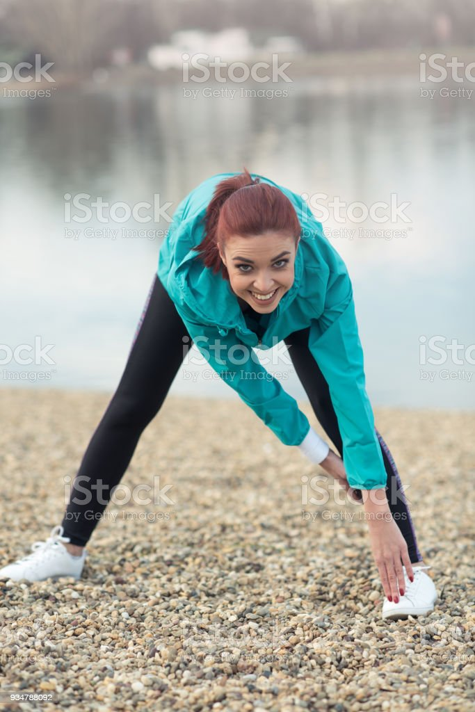 Girl warms up before a run stock photo