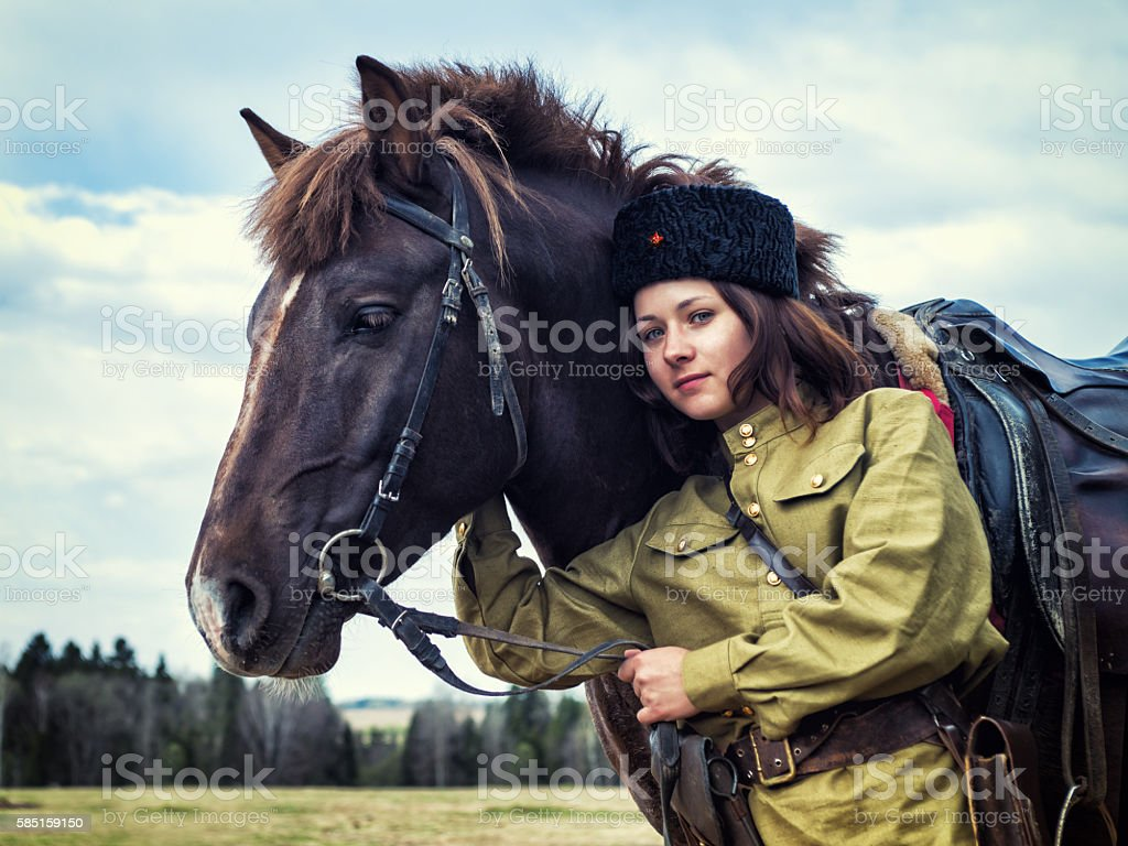 Girl warrior Cossack with a horse. Portrait. stock photo