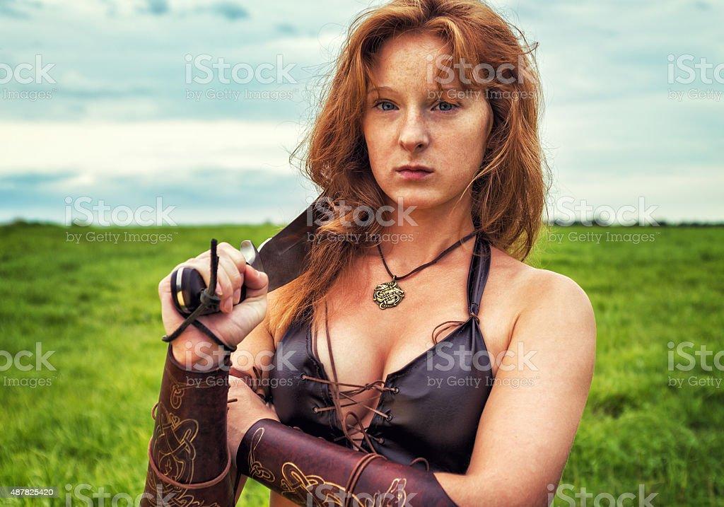 Girl warrior in the field. Portrait stock photo