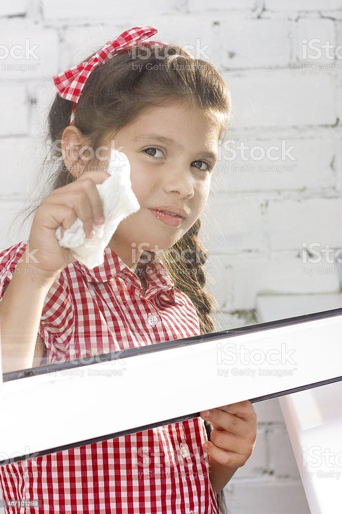 Girl wash window royalty-free stock photo