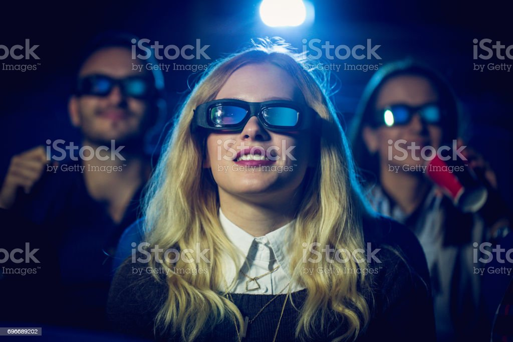 Girl watching a funny movie stock photo