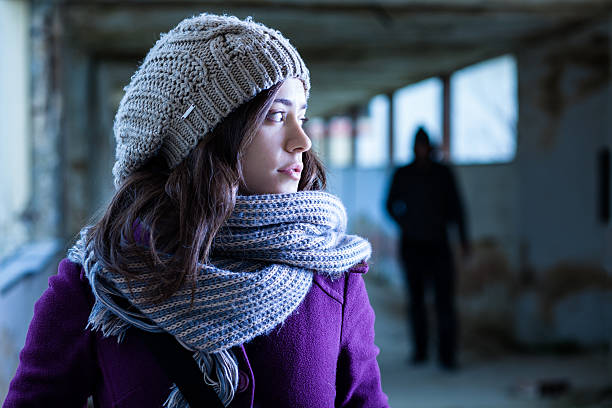 Girl watching a stalker over her shoulder Worried Woman Stalked by a Man eastern european descent stock pictures, royalty-free photos & images
