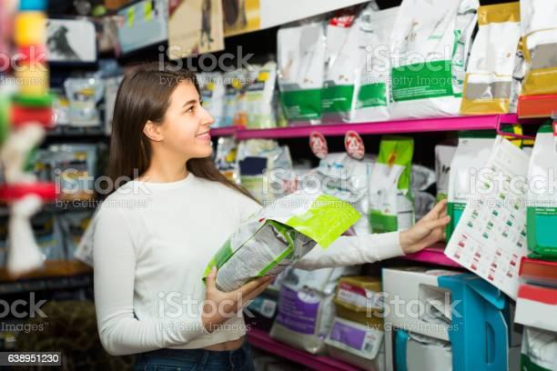 Girl watching dry food in pet store picture id638951230?b=1&k=6&m=638951230&s=612x612&h=uxnvs5ced49y6cw0yuplscg7gviacb8y6dzambp3hmw=