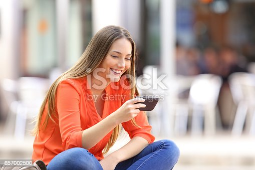 istock Girl watching media content in a phone 657002500