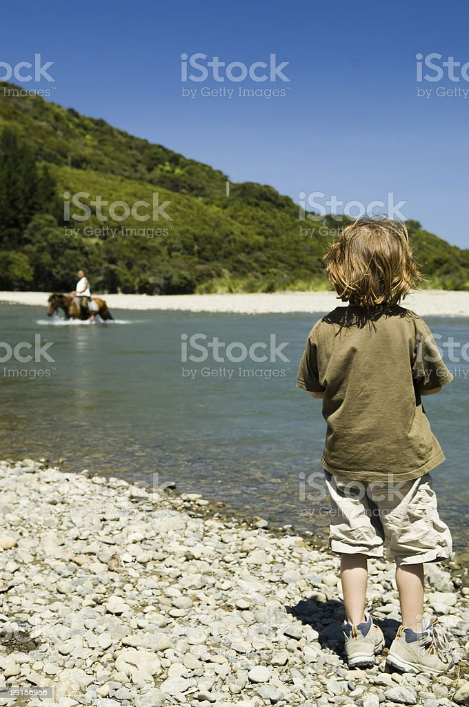 Girl watching Rider crossing the River stock photo