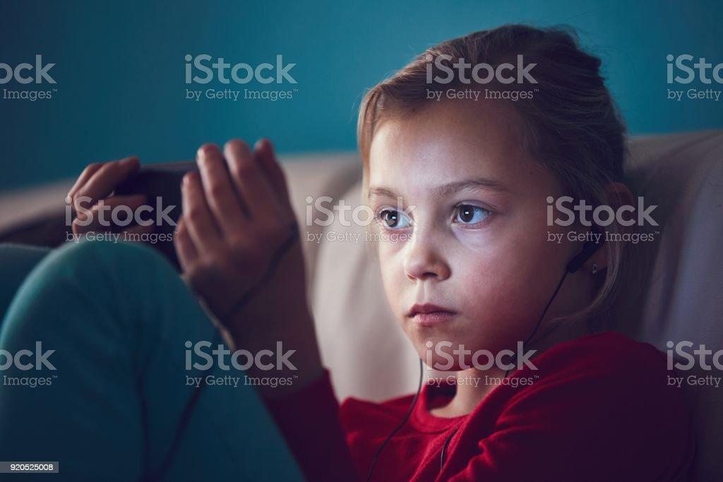 Girl watching smart phones stock photo