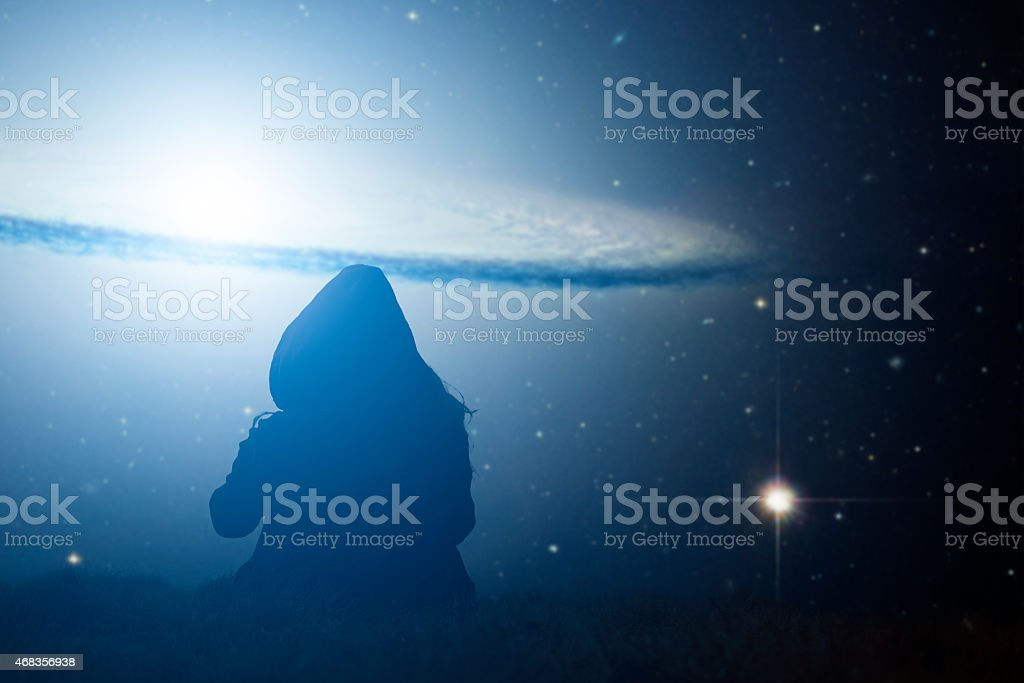 Girl watching the stars. Stars are digital illustration. royalty-free stock photo